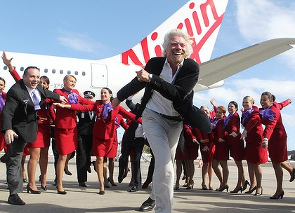 Happy days . . . John Borghett, left, and Richard Branson at Sydney Airport yesterday.