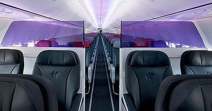 Eight plushly padded leather-clad seats at the nose of the 737 replace the premium economy benches which the then 'Virgin Blue' rolled out in 2008.