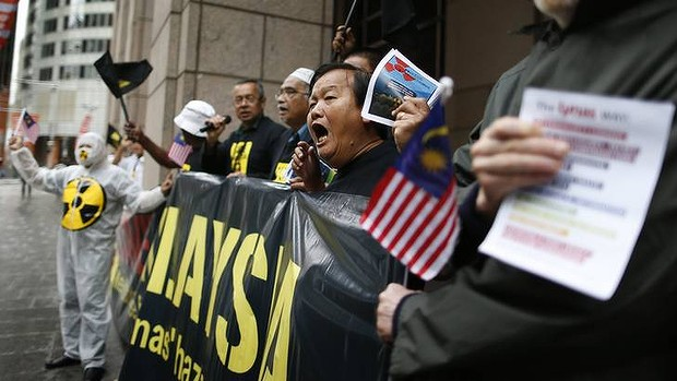 Members of the group 'Save Malaysia Stop Lynas' protest outside the Lynas 2012 annual general meeting